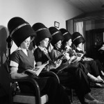 charles-steinheimer-women-aviation-workers-under-hair-dryers-in-beauty-salon-north-american-aviations-woodworth-plant